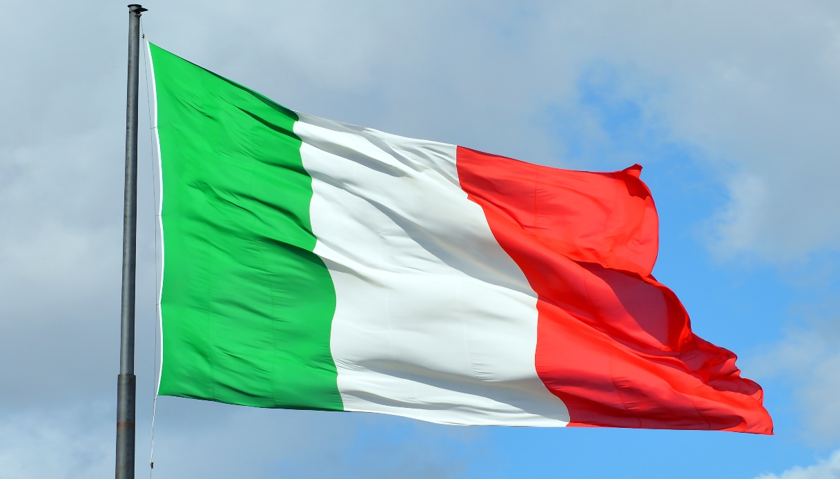 Florence, Tuscany, Italy - September 12, 2017: Italian national flag before the Railway station in Florence - Italy.